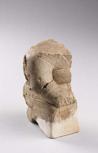 Fragments of a robed and kneeling human figure